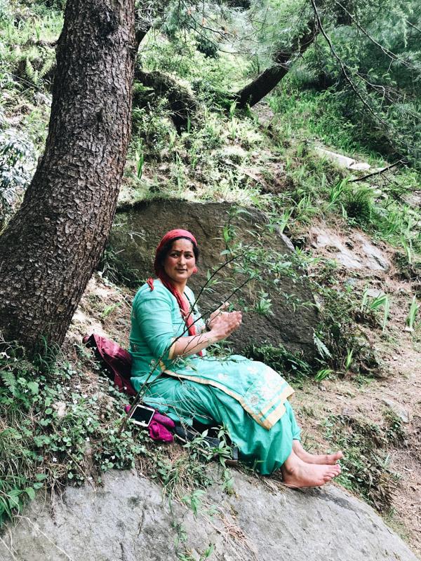 Lady sitting under a tree