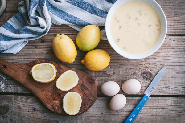 avgolemono soup with ingredients eggs and lemons