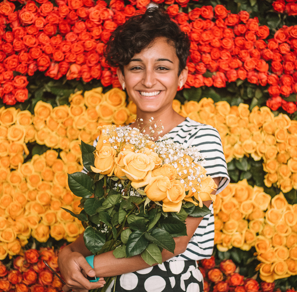 a girl holding a bunch of flowers