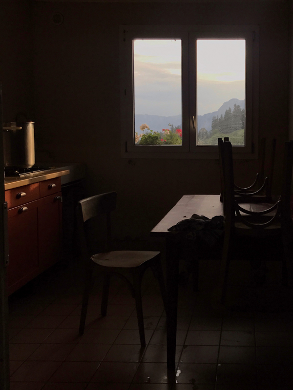 view of the mountains through the kitchen window