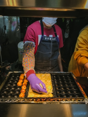 man making octopus balls
