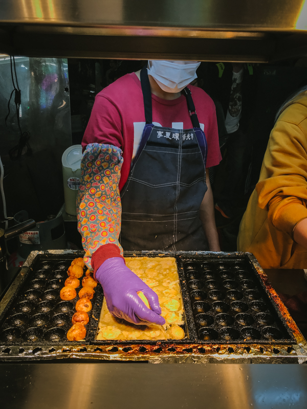 man making octopus balls