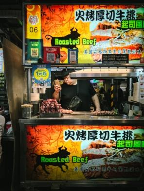 man at street food stall