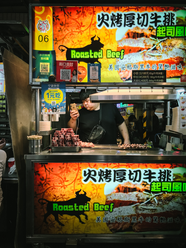 man at street food stall