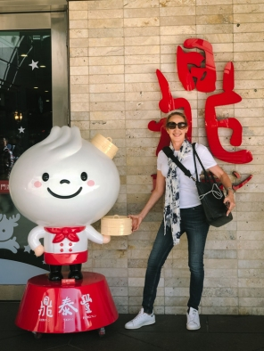 woman standing with cartoon character
