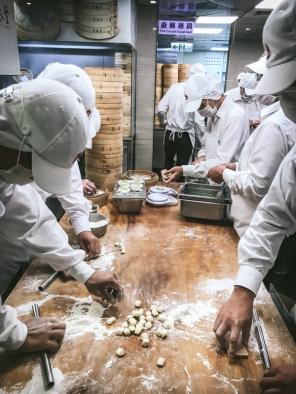 men making dumplings