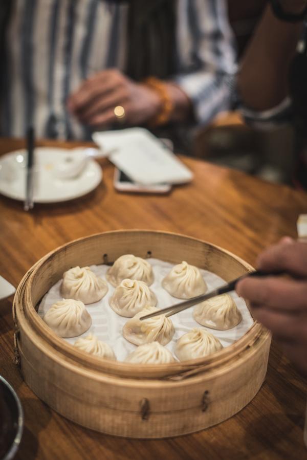 chopsticks picking up dumplings