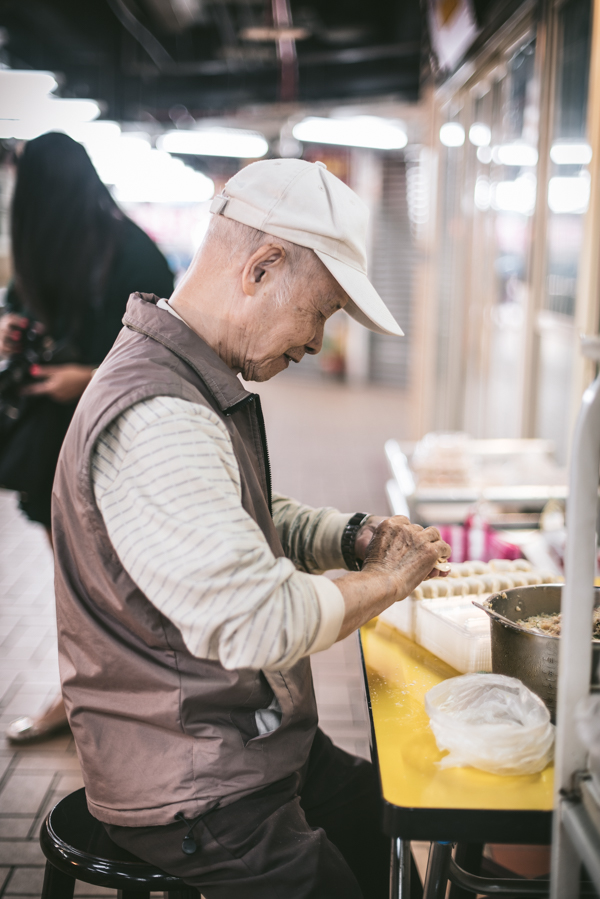 man making dumplings