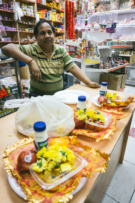 man selling prasad