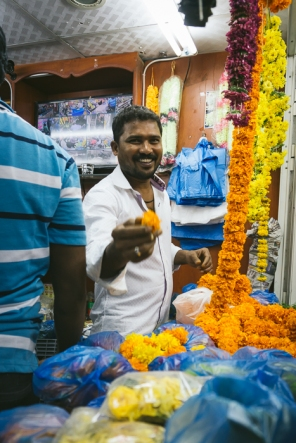 man holding marigold