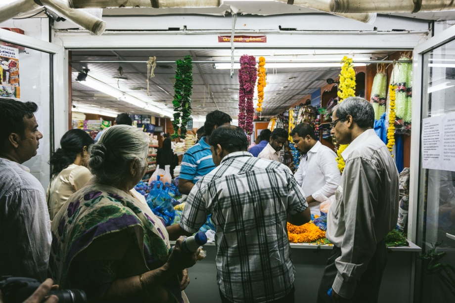 people buying garlands of flowers for Diwali
