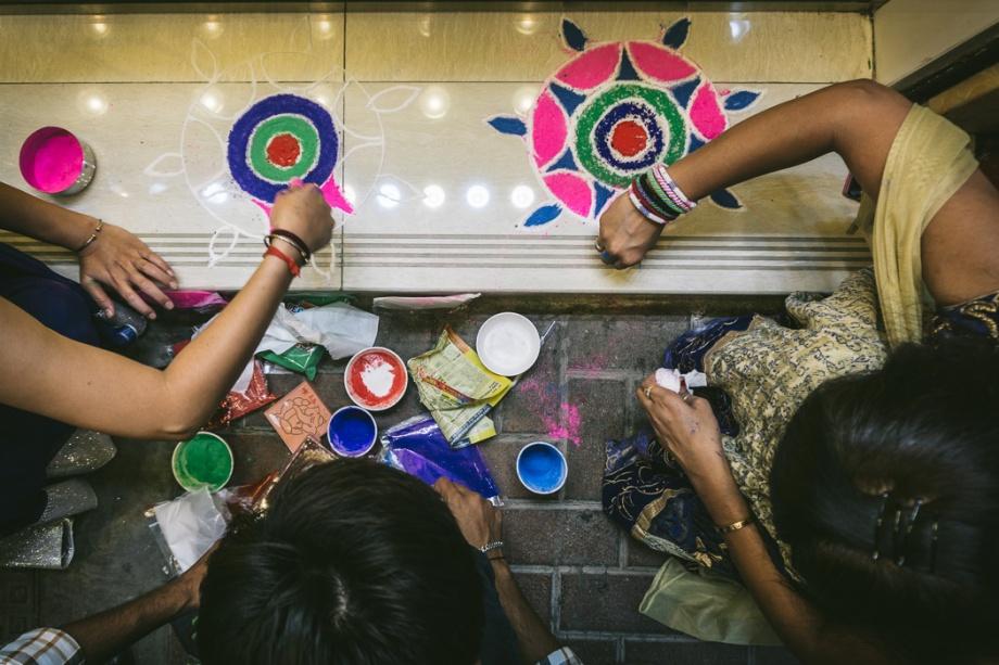 people making rangoli