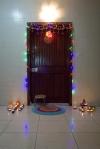 Diwali diyas by a door
