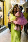 Lady holding child in pretty clothes