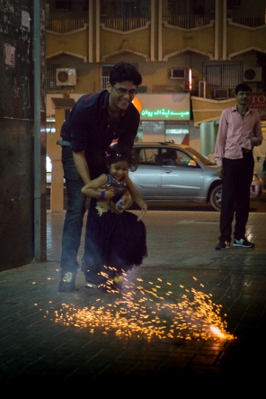 man and child with firecracker