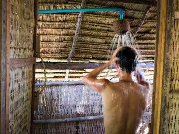 Stephen in shower made of a coconut